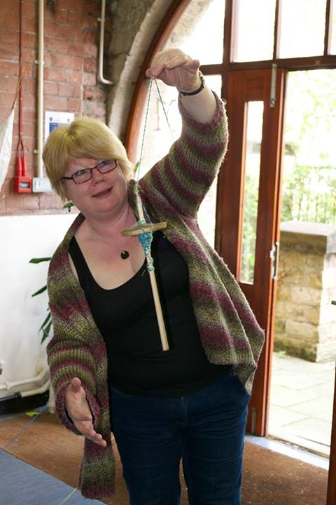Photo of Linda spinning another yarn